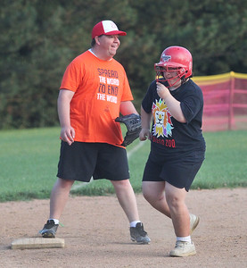 Candace H. Johnson-For Shaw Media Scott McNamee, 34, of Mundelein waits on third while Nellie Overton, 24, of Libertyville rounds the bases during the Special Recreation Association of Central Lake County (SRACLC) softball practice for the Crusaders Silver team at Deerpath Park in Vernon Hills. The Crusaders Silver team was practicing for their district tournament in Elgin on August 3rd. (7/23/19)