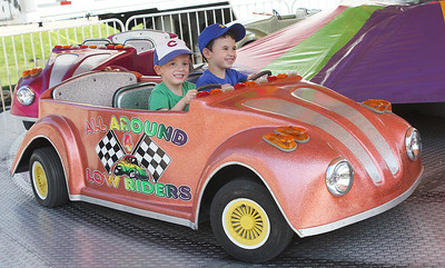 Candace H. Johnson-For Shaw Media Bradley Porch, 4, of Antioch and his brother, Alex, 6, have fun on the All Around Low Riders ride during Antioch's Taste of Summer in downtown Antioch. (7/21/19)