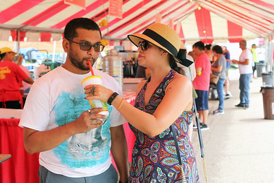 Candace H. Johnson-For Shaw Media Anirban and Sonalika Roy, of Waukegan share some lemonade from the Tres Flores & Co. booth during Antioch's Taste of Summer in downtown Antioch. (7/21/19)