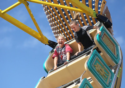 Candace H. Johnson-For Shaw Media Josie Blau, 9, and Kaylee Cook, 13, both of Antioch ride Pharoah's Fury during Antioch's Taste of Summer in downtown Antioch. (7/21/19)
