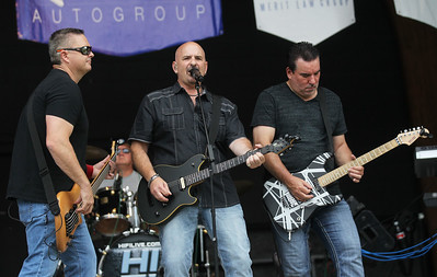 Candace H. Johnson-For Shaw Media Tyler Holcomb, Dave Mikulskis and Guy Dominick with the band called, Hi Infidelity, sing 80's rock music during Antioch's Taste of Summer in downtown Antioch. (7/21/19)