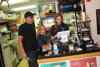 Candace H. Johnson-For Shaw Media Andy Rickman, of Arlington Heights works with his daughters, Taylor, 11, and Jenna, 16, at the cash register at Abel's Restaurant in downtown Grayslake.  (7/7/20)