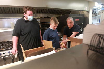 Candace H. Johnson-For Shaw Media Abel Bonilla, of Arlington Heights, owner, (on right) works with his son, Abel,Jr., and grandson, Kyle Rickman,14, of Arlington Heights as they make tortilla chips in the kitchen at Abel's Restaurant in downtown Grayslake.  (7/7/20)