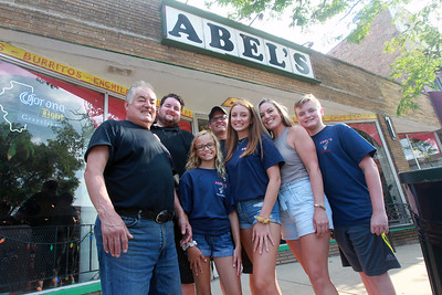 Candace H. Johnson-For Shaw Media Abel Bonilla, of Arlington Heights, owner, stands with his two children Abel, Jr., and Elizabeth Rickman, with her family, husband, Andy, and their children, Taylor, 11, Jenna, 16, and Kyle, 14, outside of Abel's Restaurant in downtown Grayslake. All the family pictured, except for Elizabeth Rickman, work at the restaurant. (7/6/20)