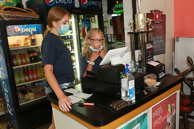 Candace H. Johnson-For Shaw Media Jenna Rickman, 16, of Arlington Heights works with her sister, Taylor, 11, at the cash register at Abel's Restaurant in downtown Grayslake.  (7/6/20)