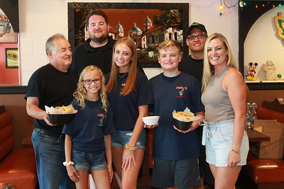 """Candace H. Johnson-For Shaw Media Abel Bonilla, of Arlington Heights, owner, stands with his two children Abel, Jr., and Elizabeth Rickman, (on right) with her family, husband, Andy, and their children, Taylor, 11, Jenna, 16, and Kyle, 14, at Abel's Restaurant in downtown Grayslake. All the family pictured, except for Elizabeth Rickman, work at the restaurant. Abel says, """"I'm living the American dream,"""" as he works with his family at the restaurant.(7/7/20)"""