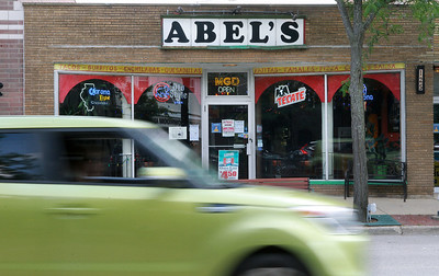Candace H. Johnson-For Shaw Media A car passes Abel's Restaurant in downtown Grayslake.  (7/6/20)
