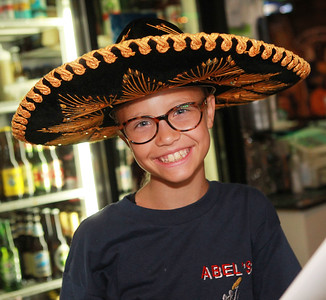 Candace H. Johnson-For Shaw Media Taylor Rickman, 11, of Arlington Heights wears a sombrero at Abel's Restaurant in downtown Grayslake. Taylor works at the restaurant with her family, including her grandfather, Abel Bonilla, the owner.  (7/7/20)