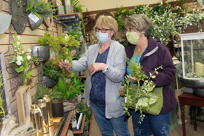Candace H. Johnson-For Shaw Media Kim Dunlap and Debbie Harding, both of McHenry shop for silk flowers at Hannah's on Lake Street in downtown Antioch. (6/26/20)