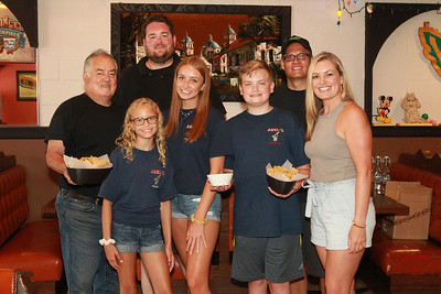 Candace H. Johnson-For Shaw Media Abel Bonilla, of Arlington Heights, owner, stands with his two children, Abel, Jr., and Elizabeth Rickman, (on right) with her family, husband, Andy, and their children, Taylor, 11, Jenna, 16, and Kyle, 14, at Abel's Restaurant in downtown Grayslake. All the family pictured, except for Elizabeth Rickman, work at the restaurant. (7/7/20)