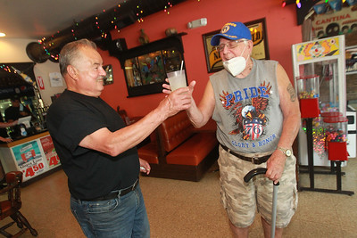 Candace H. Johnson-For Shaw Media Abel Bonilla, of Arlington Heights, owner, serves a glass of lemonade to Bob Stroud, 90, of Grayslake, a customer who has been coming to Abel's Restaurant in downtown Grayslake for over seventeen years.  (7/6/20)