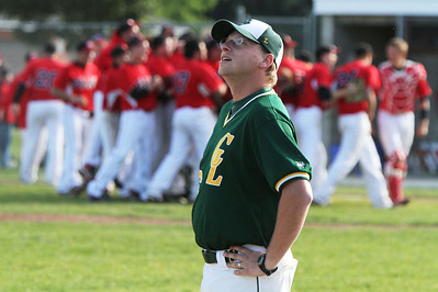 John Konstantaras/For Shaw Media Crystal Lake South head coach Brian Bogda looks as Grant players celebrate their 5-2 IHSA Class 4A Sectional Semifinal win at Peterson Park in McHenry Friday June 1, 2012. The Bulldogs won the game 5-2.  John Konstantaras photo for the Northwest Herald