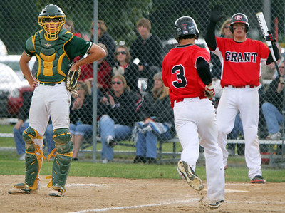 John Konstantaras/For Shaw Media Crystal Lake South catcher Dom Winiecki (8) waits for the ball as Grant's Jordan Villarreal scores on a hit by Jared Helmich during the second inning of their IHSA Class 4A Sectional Semifinal game at Peterson Park in McHenry Friday June 1, 2012. The Bulldogs won the game 5-2.  John Konstantaras photo for the Northwest Herald