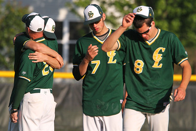 John Konstantaras/For Shaw Media Crystal Lake South's Will Ahsmann (3) gets a hug from coach Chuck Chuck Ahsmann (left) as Zack Geib (7) and Crystal Lake South's Dom Winiecki (8) walk off the field after their 5-2 IHSA Class 4A Sectional Semifinal loss to Grant at Peterson Park in McHenry Friday June 1, 2012.   John Konstantaras photo for the Northwest Herald
