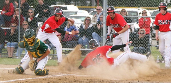 John Konstantaras/For Shaw Media Crystal Lake South catcher Dom Winiecki (8) stops the ball as Grant's Jake Ring scores on a 3 RBI double by Jordan Villarreal during the second inning of their IHSA Class 4A Sectional Semifinal game at Peterson Park in McHenry Friday June 1, 2012. The Bulldogs won the game 5-2.