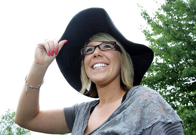 H. Rick Bamman - hbamman@shawmedia.com Brandi Weber secures her hat during a recent breezy day. Weber was diagnosed with Stage 2 melanoma, that evetually spread to her Lymph Nodes. She also had other surgeries and 6 months of chemotherapy.