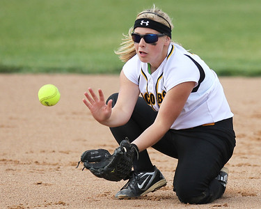 Mike Greene - mgreene@shawmedia.com Jacobs' Maggie Hansen fields a grounder on the infield during the Class 4A Cary-Grove Sectional semifinals against Hononegah Friday, June 1, 2012 in Cary. Jacobs won the game 3-0 to advance to the finals Saturday against Carmel.