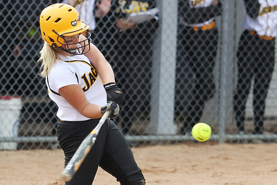 Mike Greene - mgreene@shawmedia.com Jacobs' Maggie Hansen makes contact with the ball driving in a run during the Class 4A Cary-Grove Sectional semifinals against Hononegah Friday, June 1, 2012 in Cary. Jacobs won the game 3-0 to advance to the finals Saturday against Carmel.