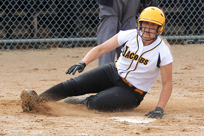 Mike Greene - mgreene@shawmedia.com Jacobs' Alyssa Lach slides safely into home plate in the third inning of the Class 4A Cary-Grove Sectional semifinals against Hononegah Friday, June 1, 2012 in Cary. Jacobs won the game 3-0 to advance to the finals Saturday against Carmel.