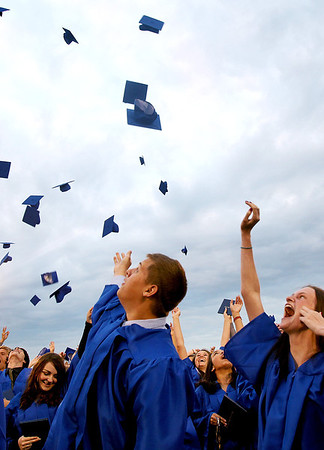 Sarah Nader - snader@shawmedia.com Jennifer Bear(right), 18, of Johnsburg throws up her cap during the 2012 Johnsburg High School Commencement on Friday, June 1, 2012. This fall Jewell plans to major in accounting at Northern Illinois University.