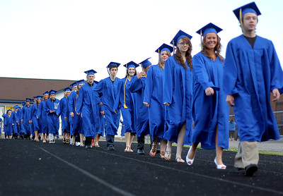 Sarah Nader - snader@shawmedia.com Graduates walk onto the football field during the 2012 Johnsburg High School Commencement on Friday, June 1, 2012.