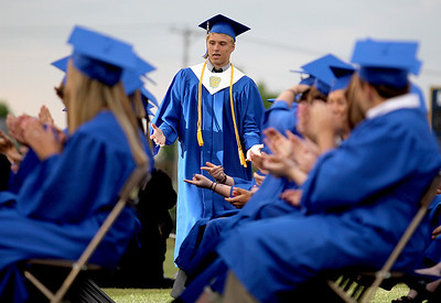 Sarah Nader - snader@shawmedia.com Class president Dan Fox walks back to his seat during the 2012 Johnsburg High School Commencement on Friday, June 1, 2012.