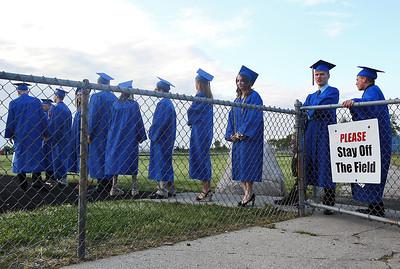 Sarah Nader - snader@shawmedia.com Graduates walk onto the football field during the 2012 Johnsburg High School Commencement on Friday, June 1, 2012.