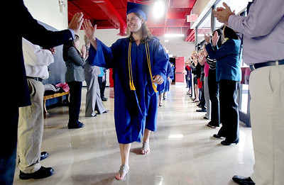 Sarah Nader - snader@shawmedia.com Andrea Lindal (center) is greeted by staff and faculty before the 2012 Johnsburg High School Commencement on Friday, June 1, 2012. DeStephano plans to study Biochemistry at Indiana University next fall.