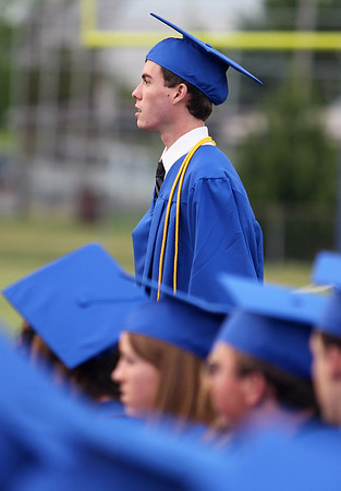Sarah Nader - snader@shawmedia.com Valedictorian Nickolas Schnell walks onto the football field during the 2012 Johnsburg High School Commencement on Friday, June 1, 2012.