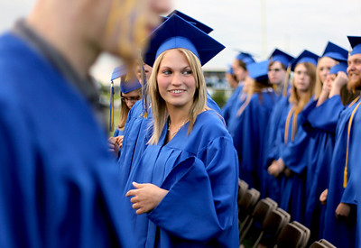 Sarah Nader - snader@shawmedia.com Courtney Kohl, 18, of Johnsburg waits at her seat during the 2012 Johnsburg High School Commencement on Friday, June 1, 2012.