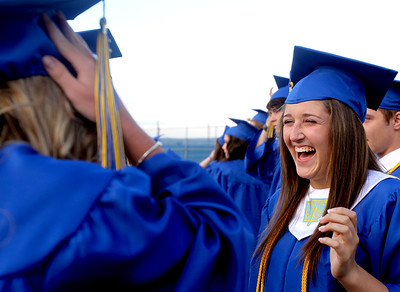 Sarah Nader - snader@shawmedia.com Lauren DeStephano, 17, of Johnsburg laughs with friends before the 2012 Johnsburg High School Commencement on Friday, June 1, 2012. DeStephano plans to study Biochemistry at Indiana University next fall.