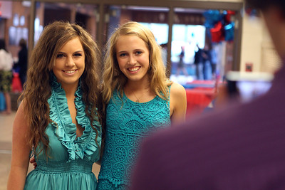 Mike Greene - mgreene@shawmedia.com Kayley Dvorak (left) and Erin Van Herzeele pose for a photo prior to the start of commencement ceremonies for Marian Central Catholic High School Friday, June 1, 2012 in Woodstock.