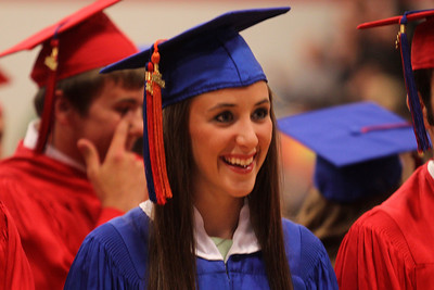 Mike Greene - mgreene@shawmedia.com Simone Awe smiles during the start of commencement ceremonies for Marian Central Catholic High School Friday, June 1, 2012 in Woodstock.