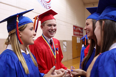 Mike Greene - mgreene@shawmedia.com Jessica Lyle, Jack Murray, Allison Kotleba and Anna Paffrath joke while waiting for the start of commencement ceremonies for Marian Central Catholic High School Friday, June 1, 2012 in Woodstock.