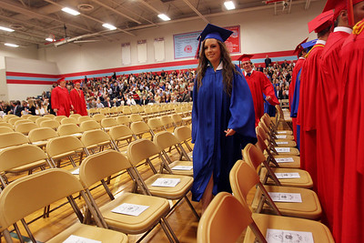 Mike Greene - mgreene@shawmedia.com Kayley Dvorak takes her seat during the start of commencement ceremonies for Marian Central Catholic High School Friday, June 1, 2012 in Woodstock.