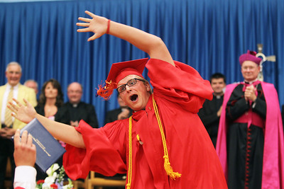 Mike Greene - mgreene@shawmedia.com Gerry McMaster leads fellow graduates in celebration following receipt of their diplomas as Bishop David J. Malloy (right) watches on during commencement ceremonies for Marian Central Catholic High School Friday, June 1, 2012 in Woodstock.