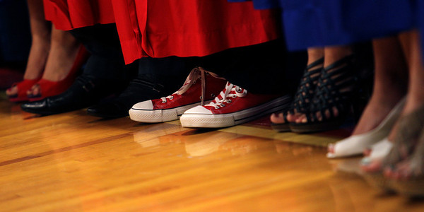 Mike Greene - mgreene@shawmedia.com Tim Manion's red Converse All-Stars stand out during commencement ceremonies for Marian Central Catholic High School Friday, June 1, 2012 in Woodstock.