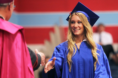 Mike Greene - mgreene@shawmedia.com Taylor Ducett prepares to shake hands with Bishop David J. Malloy while receiving her diploma during commencement ceremonies for Marian Central Catholic High School Friday, June 1, 2012 in Woodstock.