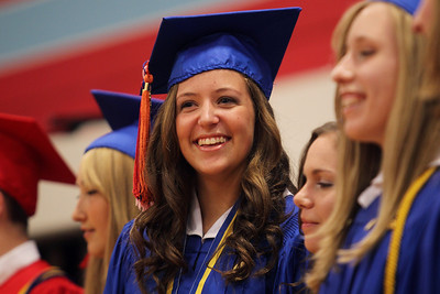 Mike Greene - mgreene@shawmedia.com Katie Simmons smiles while looking into the crowd during commencement ceremonies for Marian Central Catholic High School Friday, June 1, 2012 in Woodstock.