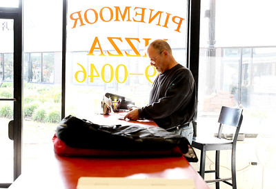 Sarah Nader - snader@shawmedia.com Owner Dick Trownsell takes phone orders while working at Pinemoor Pizza in Crystal Lake on Friday, June 1, 2012. Pinemoor Pizza has been serving the Crystal Lake area for 60 years.