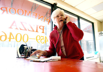 Sarah Nader - snader@shawmedia.com Owner Ann Trownsell takes phone orders while working at Pinemoor Pizza in Crystal Lake on Friday, June 1, 2012. Pinemoor Pizza has been serving the Crystal Lake area for 60 years.