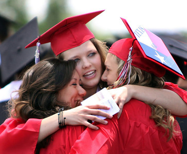 Jeff Krage – For the Northwest Herald Huntley High School graduate Kelsey Seitz, center, hugs Aryanna Burgos, left, and Kayla Linthicum outside the Sears Centre before Saturday's ceremonies. Hoffman Estates 6/2/12