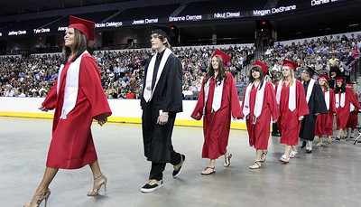 Jeff Krage for the Northwest Herald The Huntley High School processional at the Sears Centre during Saturday's graduation ceremonies.