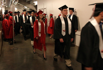 Jeff Krage for the Northwest Herald Huntley High School graduates head toward their respective positions inside the Sears Centre before Saturday's ceremonies.