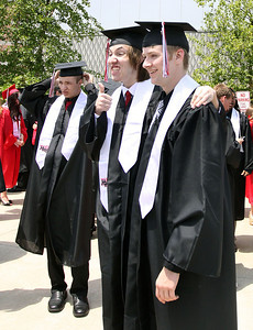 Jeff Krage for the Northwest Herald Huntley High School graduate's Danny Stock, right, and Ryan Himebaugh pose for a picture outside the Sears Centre before the start of Saturday's ceremonies.