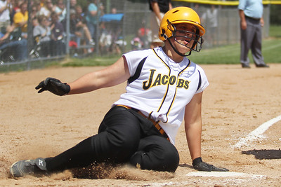 Mike Greene - mgreene@shawmedia.com Jacobs' Alyssa Lach slide home safely during the Class 4A Cary-Grove Sectional finals against Carmel Saturday, June 2, 2012 in Cary. Jacobs won the game 7-0 to advance to the Judson University Supersectional against Elk Grove Monday.
