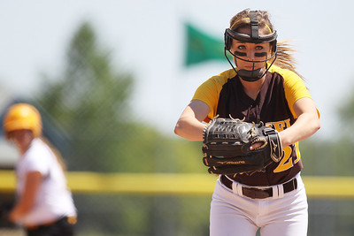 Mike Greene - mgreene@shawmedia.com Carmel's Nicole Bitter pitches in the first inning of the Class 4A Cary-Grove Sectional finals against Jacobs Saturday, June 2, 2012 in Cary. Jacobs won the game 7-0 to advance to the Judson University Supersectional against Elk Grove Monday.