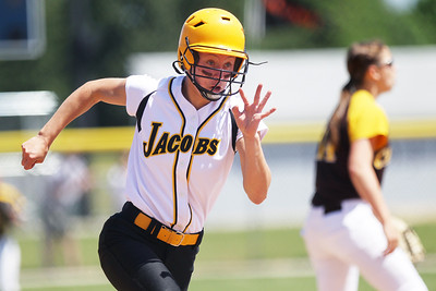 Mike Greene - mgreene@shawmedia.com Jacobs' Jacquelyn Hengler runs around third base to score in the first inning of the Class 4A Cary-Grove Sectional finals against Carmel Saturday, June 2, 2012 in Cary. Jacobs won the game 7-0 to advance to the Judson University Supersectional against Elk Grove Monday.