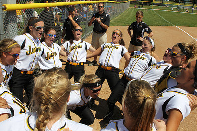 Mike Greene - mgreene@shawmedia.com Jacobs is lead in a team rally by Maggie Hansen (center) before the start of the Class 4A Cary-Grove Sectional finals against Carmel Saturday, June 2, 2012 in Cary. Jacobs won the game 7-0 to advance to the Judson University Supersectional against Elk Grove Monday.