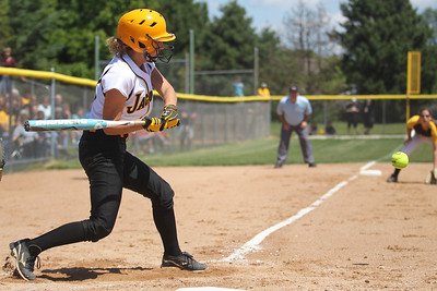 Mike Greene - mgreene@shawmedia.com Jacobs' Kelsey Cummings swings at a pitch during the Class 4A Cary-Grove Sectional finals against Carmel Saturday, June 2, 2012 in Cary. Jacobs won the game 7-0 to advance to the Judson University Supersectional against Elk Grove Monday.